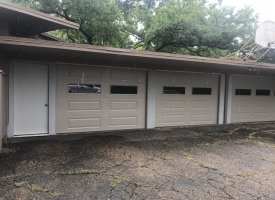 Residential carport after adding garage doors A1