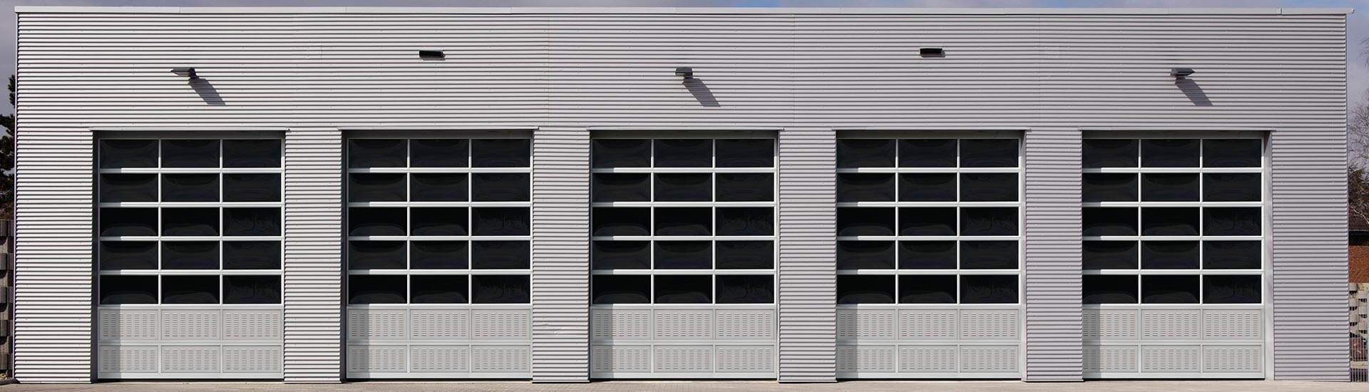 commercial ny garage gasport inc gallery woodworks door sunrise overhead