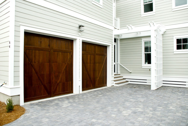 Brown residential garage doors in Coppell, TX