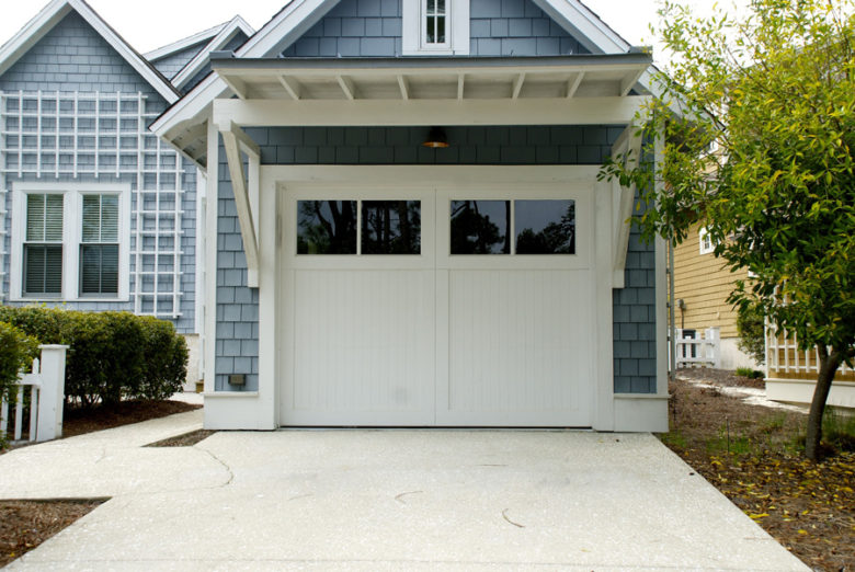 White garage doors with four windows, in Lewisville, Texas
