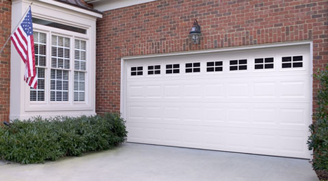 Garage Door in Fort Worth, TX with white paint on a brick house